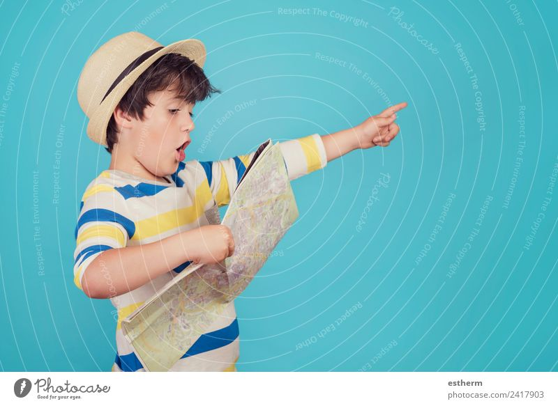 boy with hat and map on blue background Child Human being Vacation & Travel Joy Lifestyle Emotions Movement Boy (child) Tourism Freedom Trip Masculine Infancy