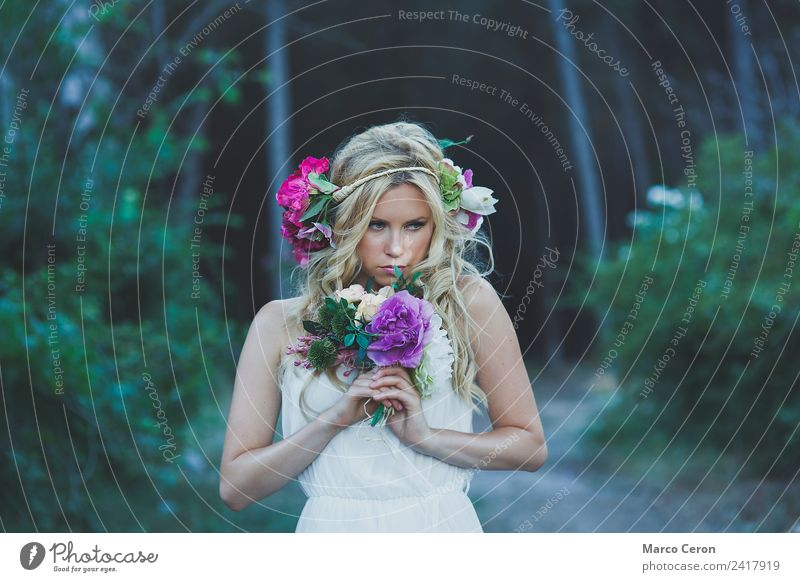 Beautiful blond woman with white dress and flowers in the forest Wedding Young woman Youth (Young adults) 1 Human being 18 - 30 years Adults Nature Plant Spring