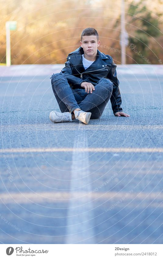 Stylish smiling teenager sitting on the road Human being Youth (Young adults) Man Green Young man White Loneliness Joy Street Adults Lifestyle Autumn