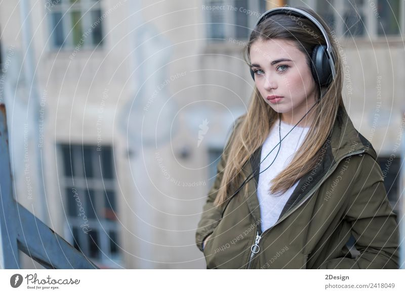 Girl listening music and looking at you Lifestyle Happy Contentment House (Residential Structure) Music School Headset Camera Technology Human being Feminine