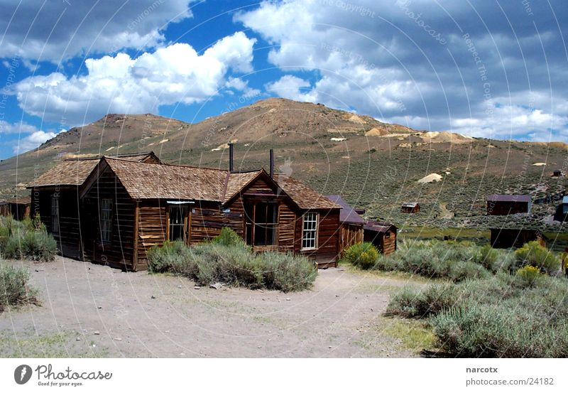Clouds Loneliness USA Desert Village Historic Americas Uninhabited Rural Vacancy Sparse Mine Mining Wooden house Clouds in the sky Wooden hut