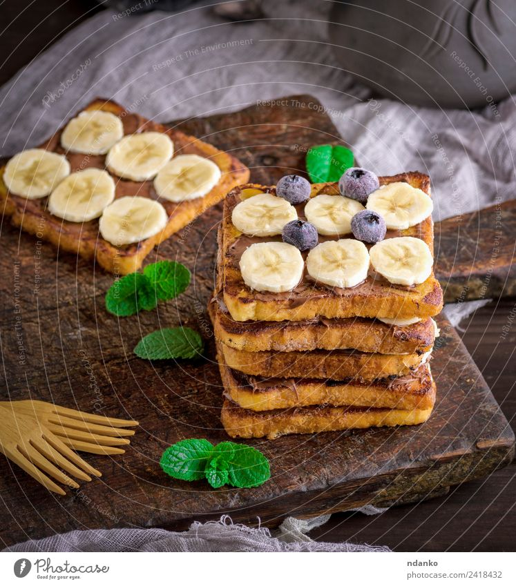 French toast for breakfast Fruit Bread Dessert Candy Nutrition Breakfast Fork Wood Eating Fresh Delicious Above Tradition french Banana chocolate background