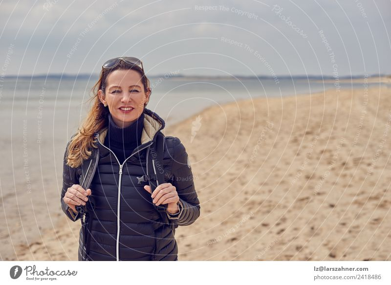 Pretty healthy woman enjoying a hike on a beach Happy Leisure and hobbies Beach Hiking Woman Adults 1 Human being 45 - 60 years Clouds Spring Autumn Coast