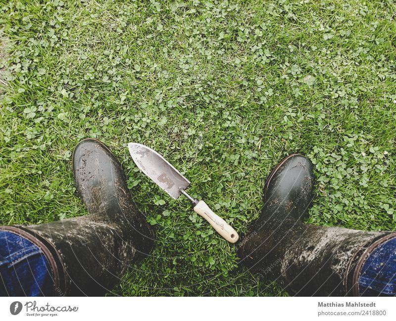 in the garden Living or residing Garden Gardening Shovel Legs Feet 1 Human being 45 - 60 years Adults Environment Nature Earth Rubber boots Work and employment