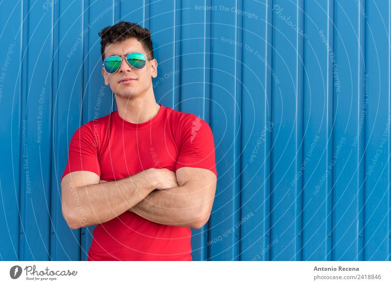 Red on blue Human being Youth (Young adults) Man Blue 18 - 30 years Adults Posture Brunette Sunglasses Warehouse Earnest 1 Person Arabia Latin Latin American