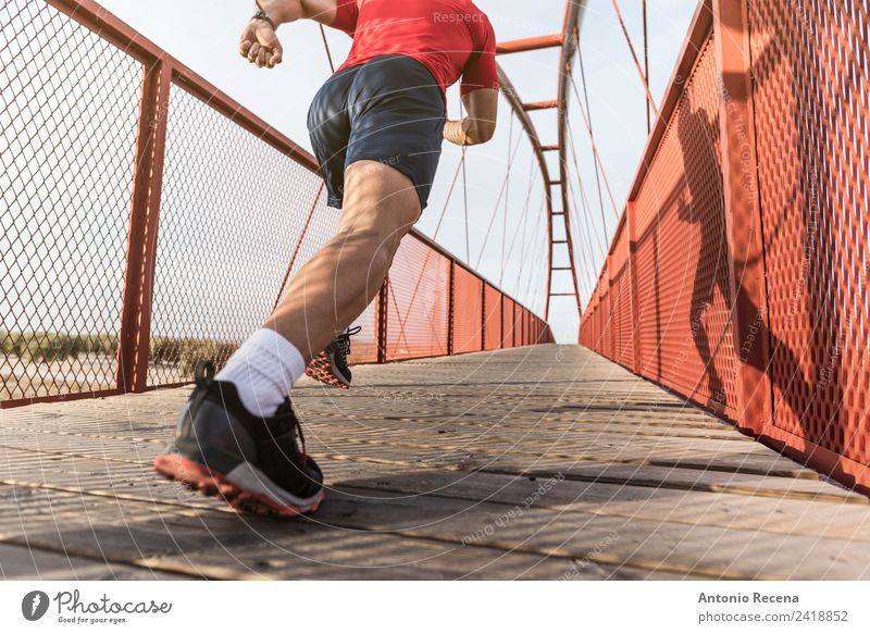 Runner on bridge Human being Man Red Adults Sports Fitness Bridge Railroad Athletic Musculature Pedestrian Jogging 1 Person Caucasian Latin