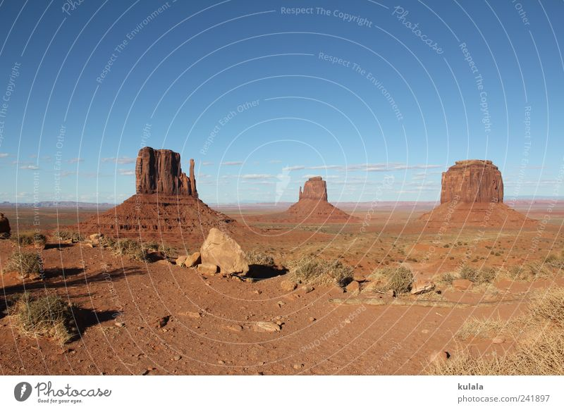 Monument Valley Far-off places Nature Landscape Earth Cloudless sky Drought Rock Mountain Canyon Desert Blue Brown Wanderlust Uniqueness Horizon Moody Tourism