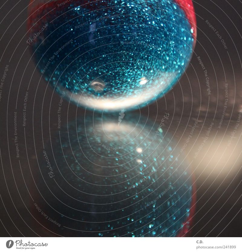 sparkle rubber Plastic Sphere Modern Round Blue Silver Rubber ball Glittering Reflection Colour photo Interior shot