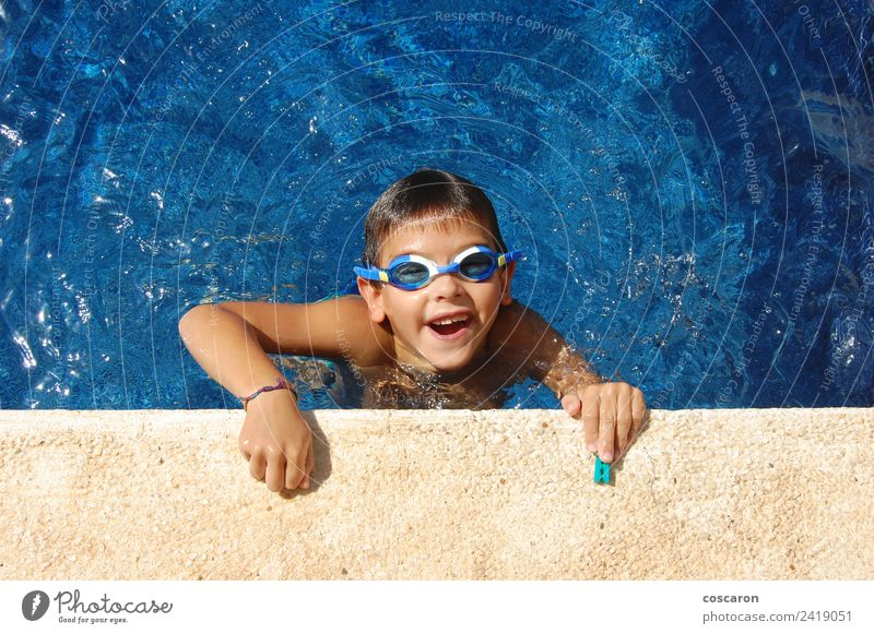 Boy with glasses in a swimming pool Joy Happy Beautiful Face Relaxation Swimming pool Leisure and hobbies Playing Vacation & Travel Summer Sun Child Infancy