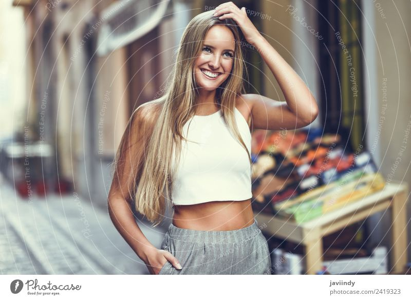 Smiling young woman in urban background Lifestyle Elegant Style Happy Beautiful Hair and hairstyles Summer Human being Young woman Youth (Young adults) Woman
