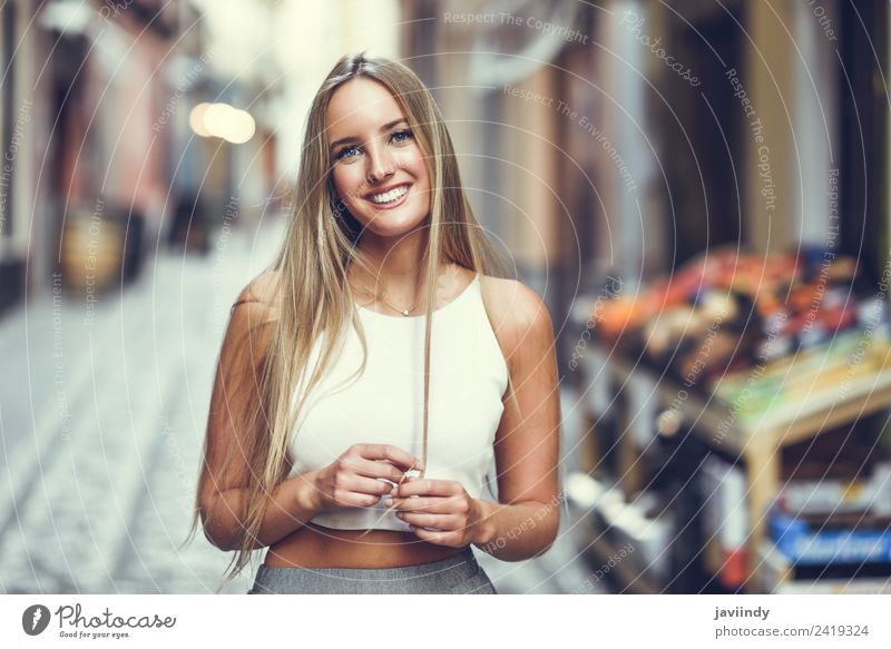 Smiling young woman in urban background Lifestyle Elegant Style Happy Beautiful Hair and hairstyles Summer Human being Feminine Young woman Youth (Young adults)