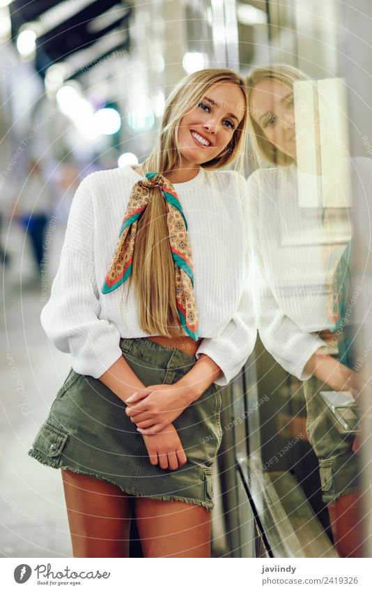 Blonde girl wearing white sweater smiling in the street Lifestyle Shopping Style Happy Beautiful Hair and hairstyles Winter Human being Feminine Young woman