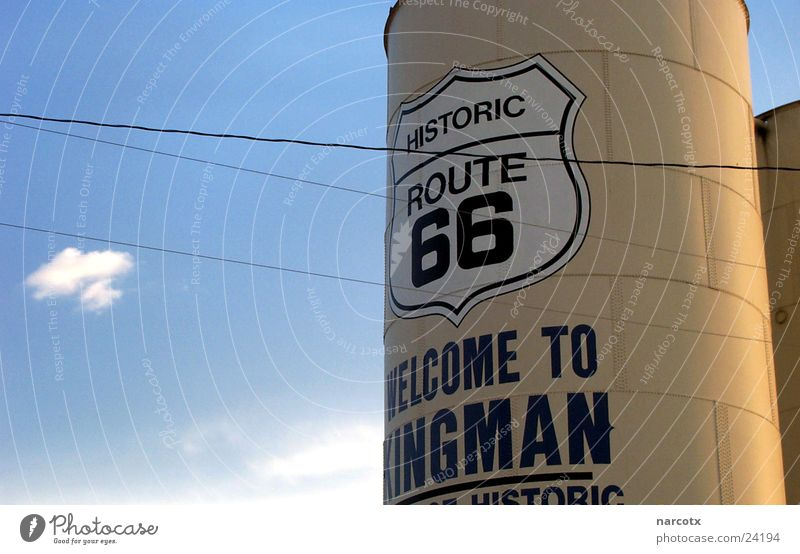 Blue USA Americas Direction Text Section of image Partially visible English Containers and vessels Silo Route 66 South West Latin script