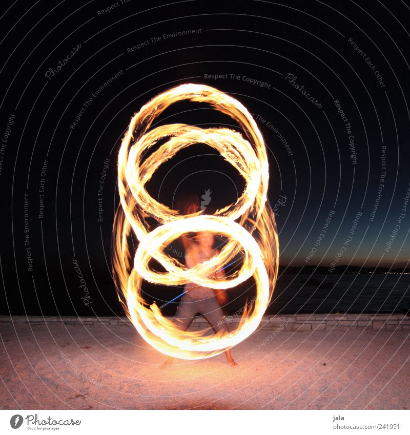 fire staff Joy Leisure and hobbies fire stick Juggler Acrobat Human being Masculine Man Adults 1 Landscape Night sky Sand Esthetic Fire piece of art Shows