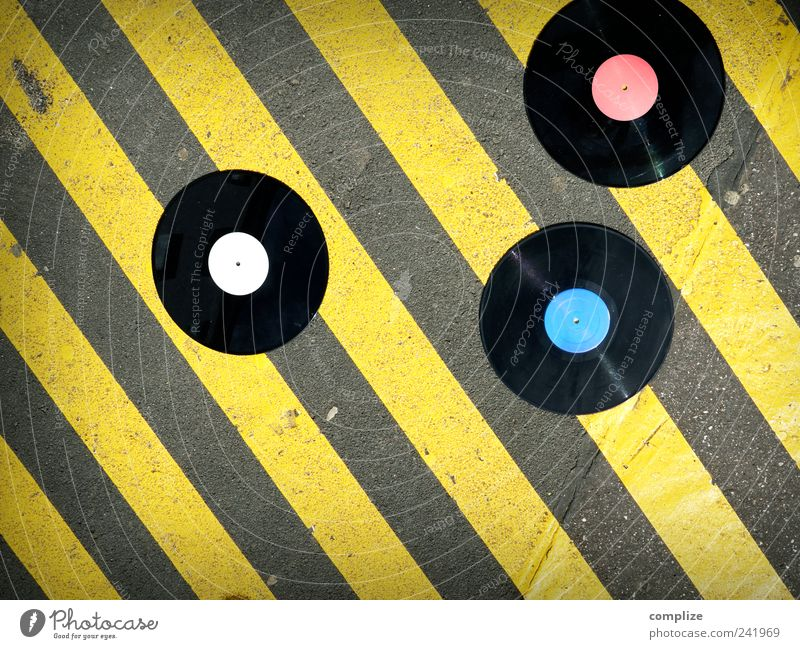 vinyl Night life Entertainment Music Club Disco Disc jockey Going out Feasts & Celebrations Clubbing Dance Art Downtown Street Road sign Stone Concrete Yellow