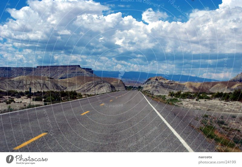 Clouds Loneliness Street Mountain Line Concrete Transport Empty USA Americas Bad weather South West