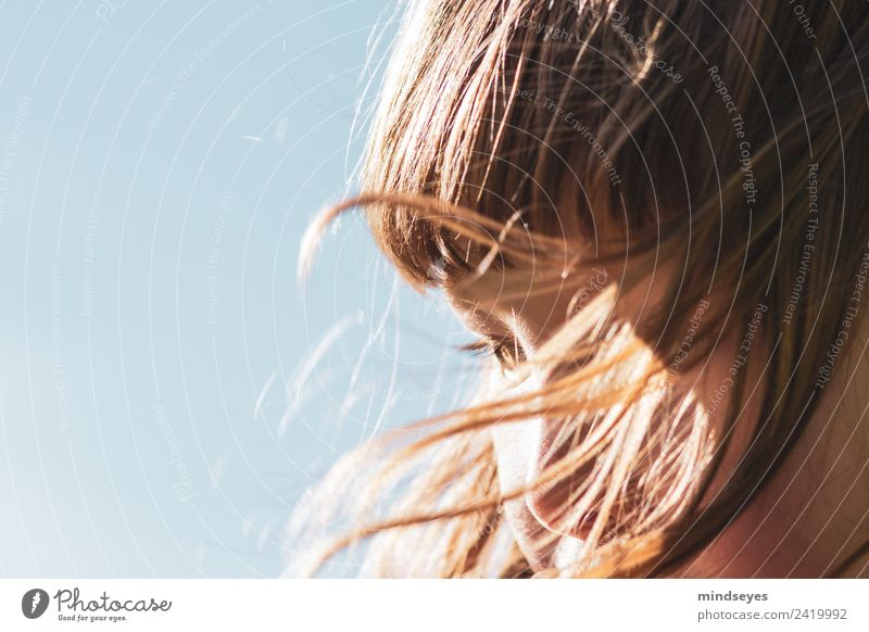 Portrait of a girl with hair blown by the wind Feminine Girl Face 1 Human being 3 - 8 years Child Infancy Sky Cloudless sky Sunlight Wind Hair and hairstyles