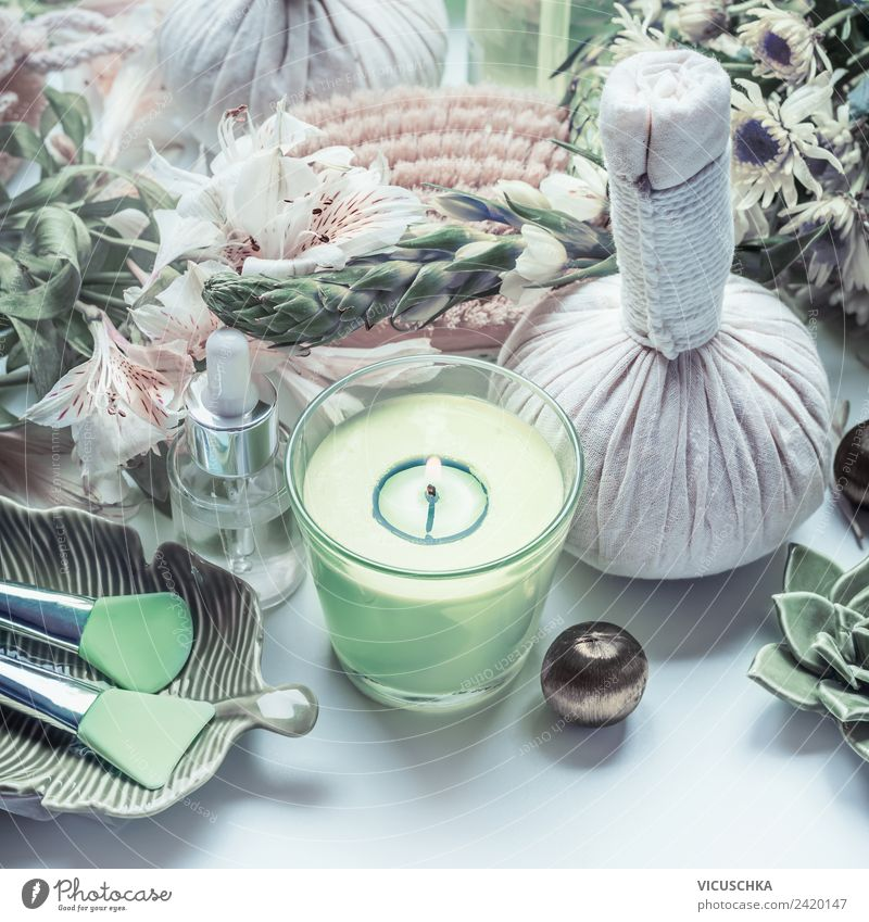 Spa and Wellnes with green candle, flowers and massage accessories Luxury Elegant Style Design Beautiful Cosmetics Cream Healthy Wellness Massage