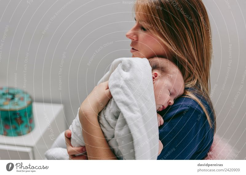 Mother hugging her sleeping baby girl Lifestyle Beautiful Calm Bedroom Child Human being Baby Woman Adults Family & Relations Infancy Arm Hand Blonde Love Sleep