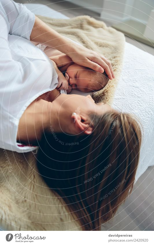 Mother hugging newborn lying on bed Lifestyle Elegant Bedroom Child Human being Baby Woman Adults Family & Relations Infancy Love Embrace Authentic Small Cute