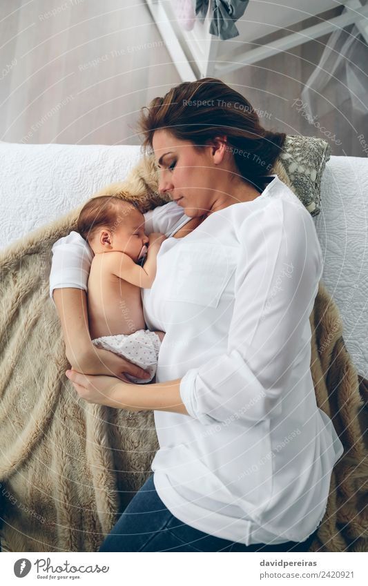 Mother hugging her newborn baby girl Lifestyle Elegant Beautiful Bedroom Child Human being Baby Woman Adults Family & Relations Aircraft Love Embrace Authentic