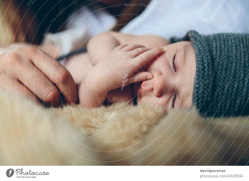 Baby sleeping on a blanket with her mother's hand Beautiful Calm Bedroom Child Human being Woman Adults Mother Family & Relations Hand Hat Love Sleep Authentic