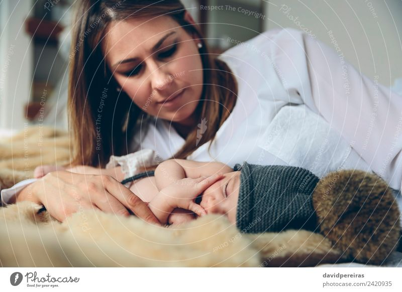 Newborn baby girl sleeping lying on blanket with her mother Beautiful Calm Bedroom Child Human being Baby Woman Adults Mother Family & Relations Hand Hat Love