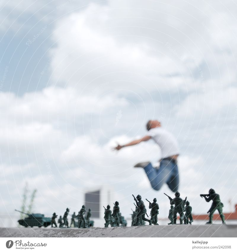 Human being Man Adults Death Jump Group Masculine Threat To fall Toys Force War Soldier Strike Weapon Blur