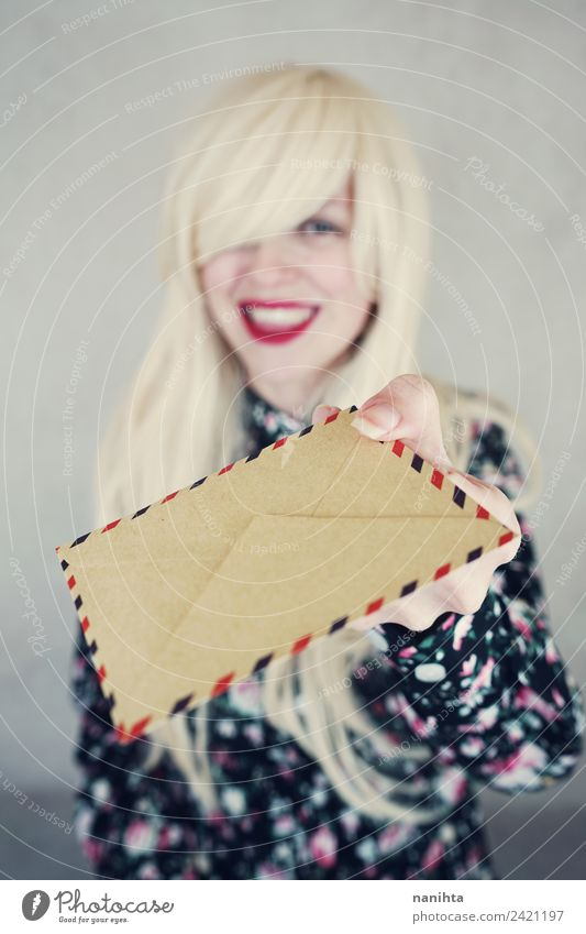 Young happy woman holding an envelope Design Hair and hairstyles Wellness Work and employment Mail To talk Human being Feminine Young woman Youth (Young adults)