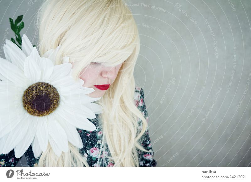 Young blonde woman posing near a huge flower Human being Youth (Young adults) Young woman Beautiful 18 - 30 years Face Adults Blossom Feminine Style Fashion