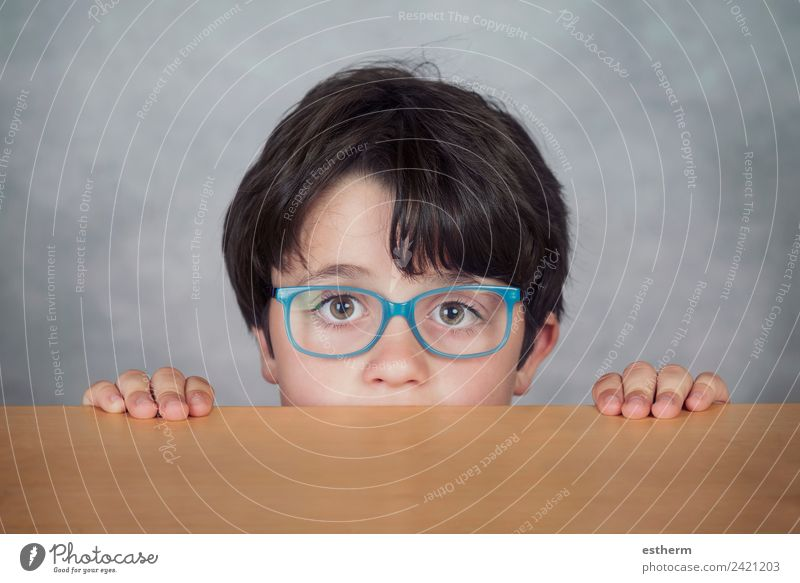 boy with glasses on a wooden table Child Human being Lifestyle Funny Emotions Boy (child) Happy Think Masculine Infancy Smiling Adventure Fitness Observe