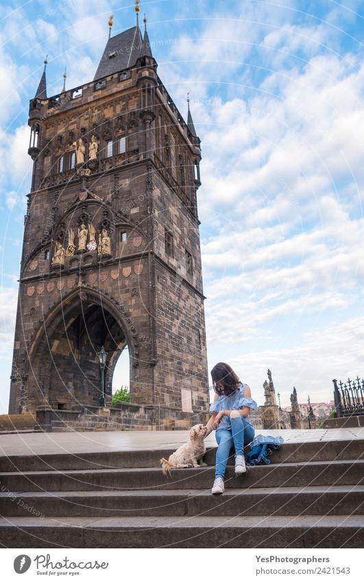 Woman with a dog in front of the tower of Charles Bridge Lifestyle Beautiful Relaxation Vacation & Travel Summer Adults Friendship Art Beautiful weather