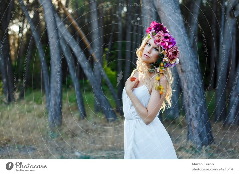 Beauty woman with romantic white dress and flowers in forest Attractive Back-light Beautiful Blonde Blue Bride Rural Calm Caucasian Elegant Fashion Woman Flower