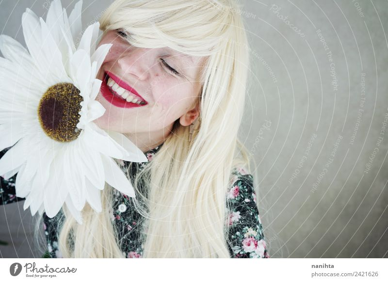 Happy blonde woman posing near a huge flower Style Design Joy Beautiful Hair and hairstyles Skin Face Lipstick Human being Feminine Woman Adults