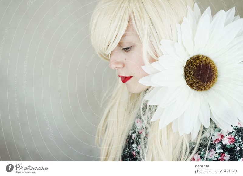 Young blonde woman posing with a huge daisy Human being Youth (Young adults) Young woman Beautiful Calm 18 - 30 years Face Adults Lifestyle Blossom Feminine