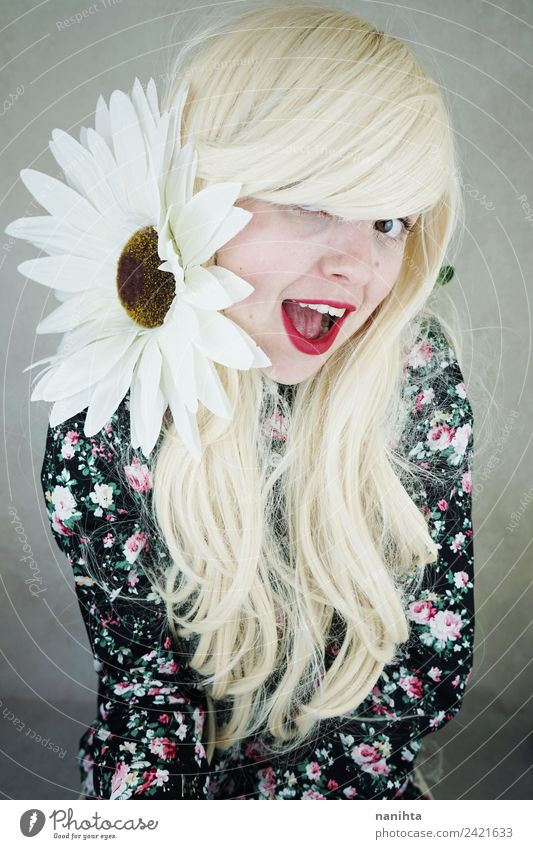 Cheerful blonde woman posing with a huge daisy Lifestyle Style Joy Beautiful Hair and hairstyles Face Wellness Human being Feminine Young woman