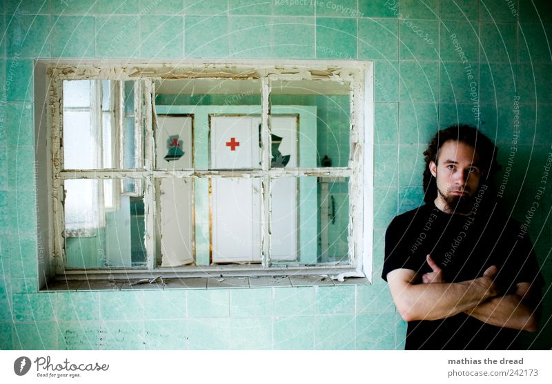 Human being Youth (Young adults) Old Green Red Window Dark Wall (building) Wall (barrier) Wait Masculine Stand Broken Gloomy Young man Creepy