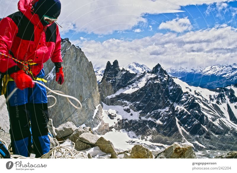 Mountain climber on the summit. Human being Man Sports Adults Success Rope Adventure Climbing Peak Jacket Brave Top Athletic Mountaineering Grasp