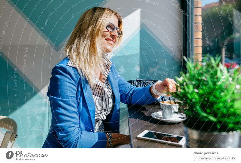 Working girl stiring coffee Coffee Lifestyle Shopping Happy Beautiful Leisure and hobbies Success Work and employment Business Telephone PDA Technology