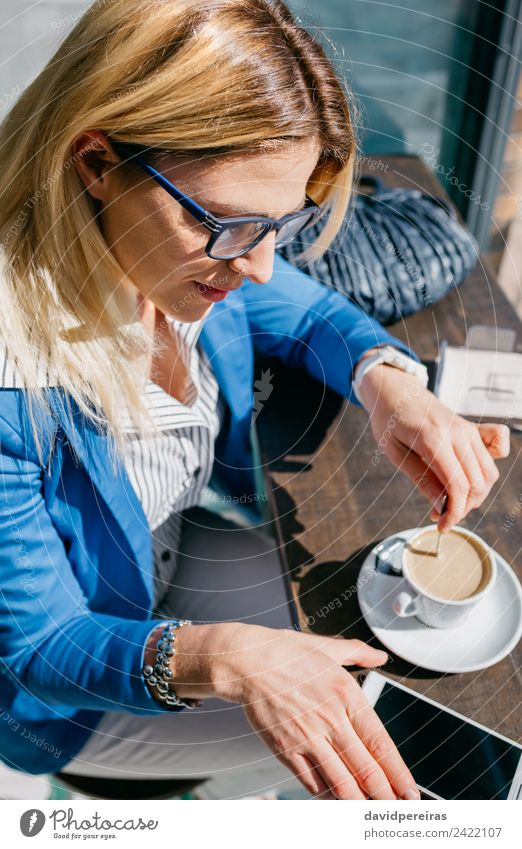 Working girl stiring coffee and looking phone Coffee Lifestyle Shopping Beautiful Leisure and hobbies Work and employment Business Telephone PDA Screen