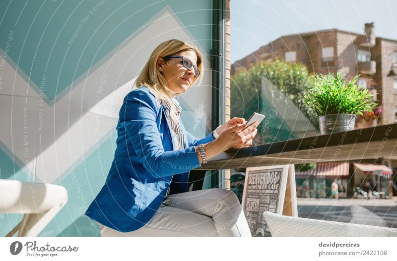 Working woman thinking and holding phone Coffee Lifestyle Shopping Happy Beautiful Leisure and hobbies Table Work and employment Telephone PDA Technology