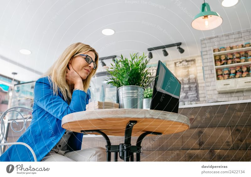 Woman working with the laptop Table Work and employment Workplace Business Computer Notebook Internet Human being Adults Plant Blonde Driving Sit Authentic