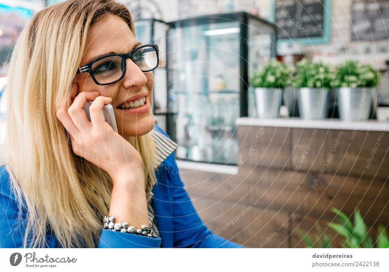 Woman talking on phone in a cafe Coffee Lifestyle Shopping Joy Happy Beautiful Leisure and hobbies Work and employment To talk Telephone PDA Technology
