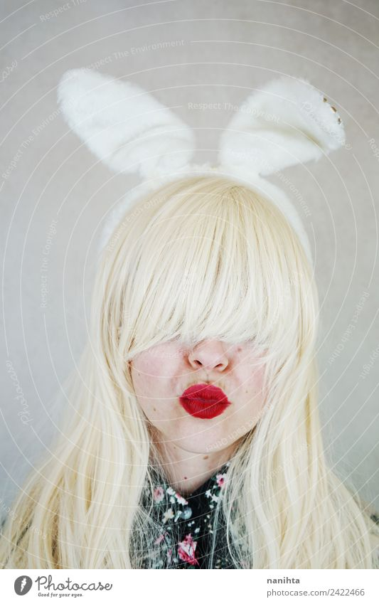 Young woman wearing rabbit ears and kissing Human being Youth (Young adults) 18 - 30 years Face Adults Feminine Style Art Feasts & Celebrations Design Retro