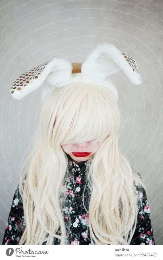 Sad blonde woman wearing bunny ears Style Exotic Hair and hairstyles Lipstick Human being Feminine Young woman Youth (Young adults) 1 18 - 30 years Adults