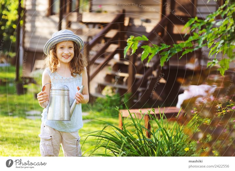 happy kid girl in hat playing little gardener Joy Happy Relaxation Playing Vacation & Travel Summer House (Residential Structure) Garden Child Infancy Flower