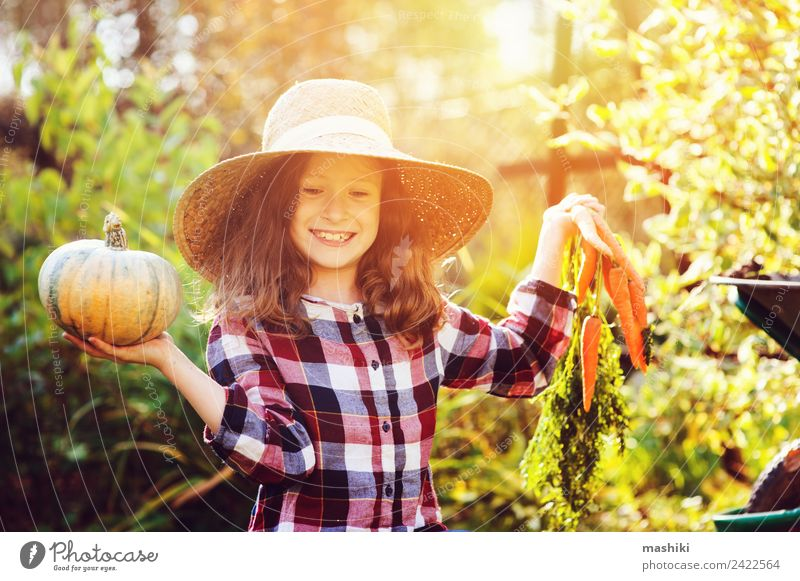 happy funny child girl in farmer hat and shirt Vegetable Lifestyle Joy Child Girl Nature Autumn Growth Fresh Funny Natural Green Harvest Carrot Pumpkin