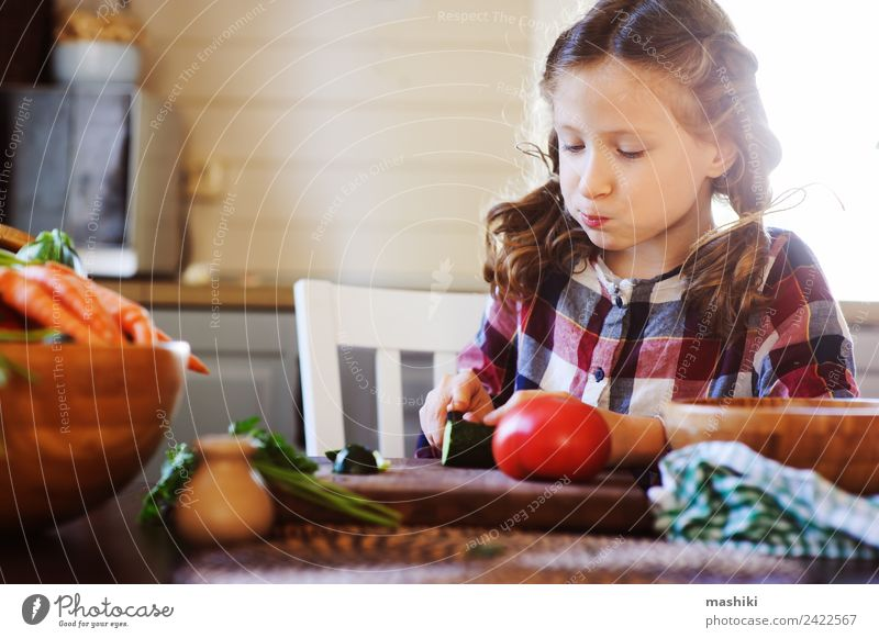 child girl helps mom to cook salad with knife Child Joy Adults Lifestyle Family & Relations Small Growth Fresh Table Kitchen Mother Vegetable Farm Home Dinner