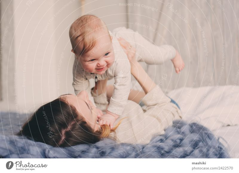 happy mother and baby playing at home in bedroom Lifestyle Joy Playing Bedroom Baby Parents Adults Mother Family & Relations Infancy Love Embrace Happiness