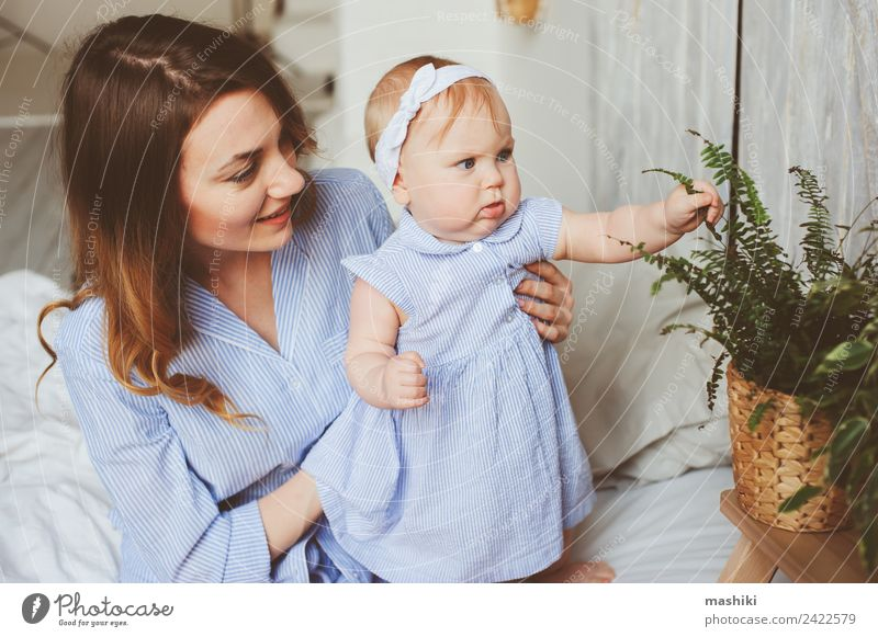 happy mother and 9 month old baby in matching pajamas Lifestyle Joy Playing Bedroom Baby Parents Adults Mother Family & Relations Infancy Hand Embrace Happiness